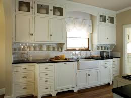 this quaint cottage kitchen features antique white shaker cabinets