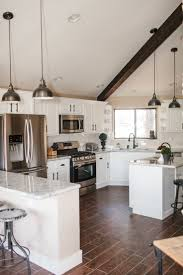 white kitchen cabinets with dark wood floors black stained wooden