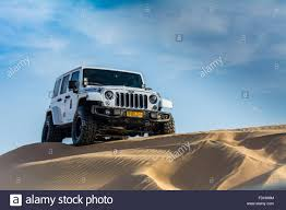 sand jeep wrangler jeep wrangler rubicon in wahiba sands desert stock photo royalty