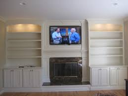 built in living room cabinets custom built mantle cabinets and bookshelves traditional living