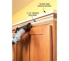 installing crown molding on kitchen cabinets how to install kitchen cabinets crown molding how to add shelves