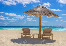 Chairs On A Beach Beach Chairs And Umbrella On A Beautiful Tropical Island Stock