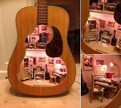 a dollhouse built inside of a guitar home design garden