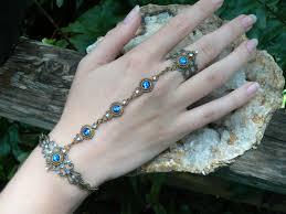 bracelet hand images Blue swarovski slave bracelet renaissance hand chain hand jpg