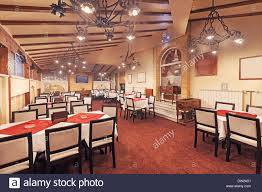 interior of a modern restaurant empty room with furniture and old