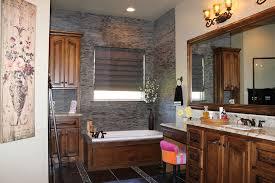 Split Face Stone Backsplash by Mediterranean Full Bathroom With Drop In Bathtub U0026 Raised Panel