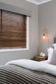 blinds for bedroom windows grey coloured pelmet combined with a timber venetian blind