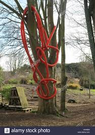 red plastic tubing used as a climbing frame in garden or