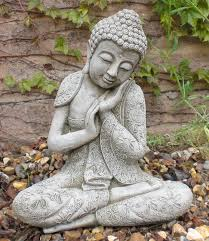 garden buddha statues beautify the landscaping with a garden