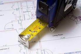 stock floor plans a tape measure on construction or architectural floor plans