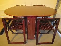 gate leg drop leaf dining table with four 4 folding chairs inset
