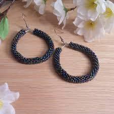 hoop beaded earrings s vow iridescent skin hoop earrings brianadragon