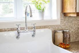 kitchen sink backsplash rustic white porcelain kitchen sink with curved faucet and tile