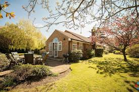 spacious bungalow with lovely garden set in a small