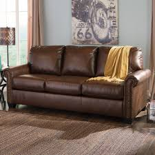 Leather Sofa Sleeper Signature Design By Larson Chocolate Transitional Bonded