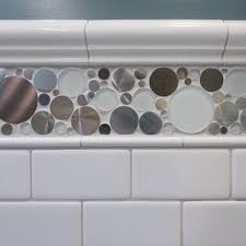 jazz up classic white subway tile with an accent tile like the