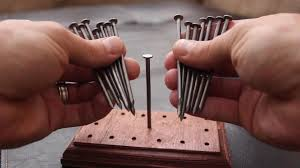how do you balance 14 nails on a single nailhead find out with