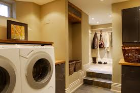 multipurpose laundry room with wooden shelves also modern washing