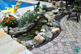 Waterfall In Backyard The Beauty Of Waterfalls In Your Backyard Eagleson Landscape Co