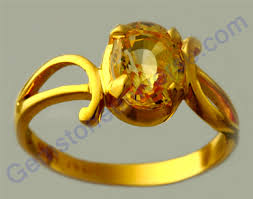 golden stone rings images Best golden yellow sapphire lustrous natural fancy gold ring jpg