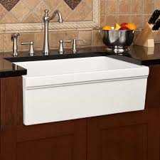 white standard farmhouse kitchen sink idea with black granite