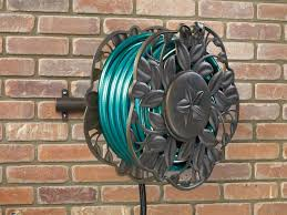 neverleak decorative wall mount hose reel with swivel feature ames