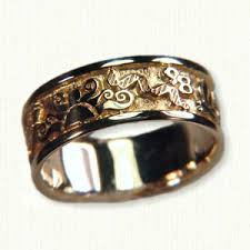 the story wedding band 14kt yellow gold story wedding band design incorporates the sun