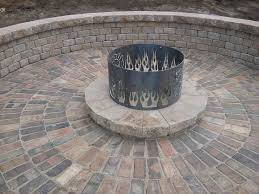 Custom Metal Fire Pits by Solheim Landscaping Provides Premier Landscape Design