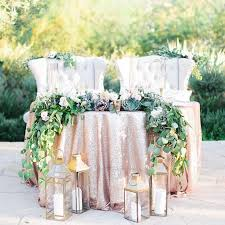 bride and groom sweetheart table rose gold sequin sweetheart table with kings chairs garland