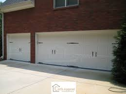 we install new carriage style garage doors curb appeal