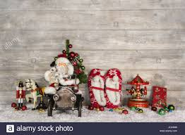 wooden witty vintage christmas background with santa and old toys