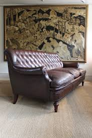 an italian buttoned leather sofa circa 1900 leather armchairs