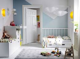 Toddler Changing Table A Children U0027s Bedroom Furnished With A White Cot With Two Drawers