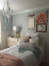 mint green bedroom walls brown rug white sheet grey curtains
