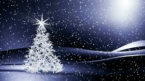 snowy christmas pictures sparkling decorated christmas tree shining in the snowy night