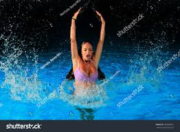 young woman swimming pool night stock photo 103859012