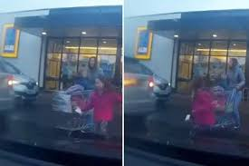 siege aldi moment is almost hit by reversing car in aldi car park