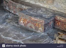 colorful bas relief carving in stone benches of aztec temple