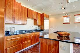light cherry kitchen cabinets and granite light tones modern kitchen room with cherry tile floor and whiskey