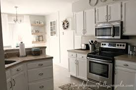 what type of behr paint for kitchen cabinets repainting the kitchen cabinets part 2 the big reveal