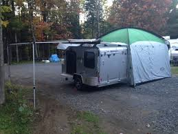 add more living space to your tiny trailer by adding an awning and