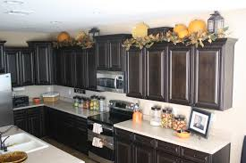 fall kitchen decorating ideas lanterns on top of kitchen cabinets decor ideas