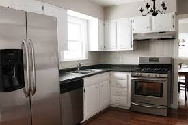 how to paint kitchen cabinets white house black shutters