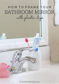 frame your bathroom mirror over plastic clips somewhat simple