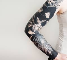 flower tattoo negative space pictures to pin on pinterest tattooskid
