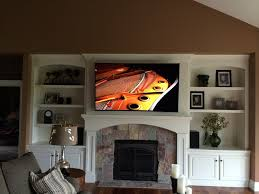 curved television mount above fireplace transitional living room