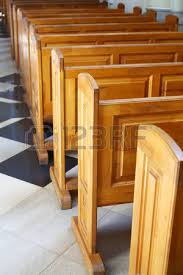 worn church pews in a basilica in italy stock photo picture and