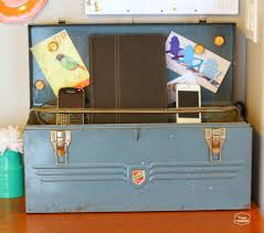 getting organized with a vintage tool box charging station the
