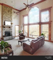 High Fireplace Living Room Livingoom High Ceiling White Sofas Fireplace Stone
