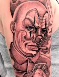 smoking latino clown tattoo on upper half sleeve golfian com